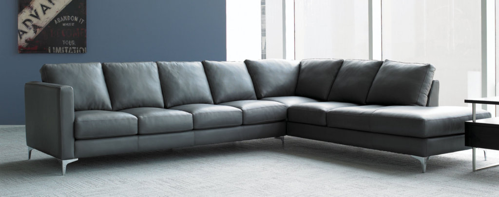 dark gray wrap around couch in a brightly lit living room