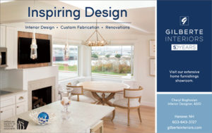 Image of dining room with customized bird chandelier and large windows looking out on a beach. Text reads: Gilberte Interiors 50 Years Inspiring Design: Interior Design, Custom Fabrication, Renovations. Cheryl Bogosian, Interior Designer, ASID, Hanover, NH 603-643-3727, gilberteinteriors.com