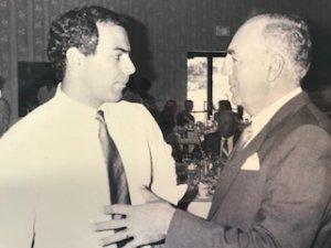 black and white photo of 2 men talking