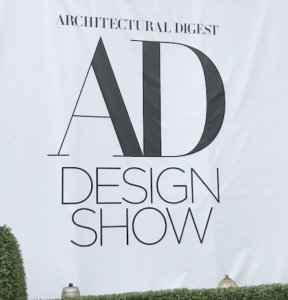 AD Design show sign, white background with black type