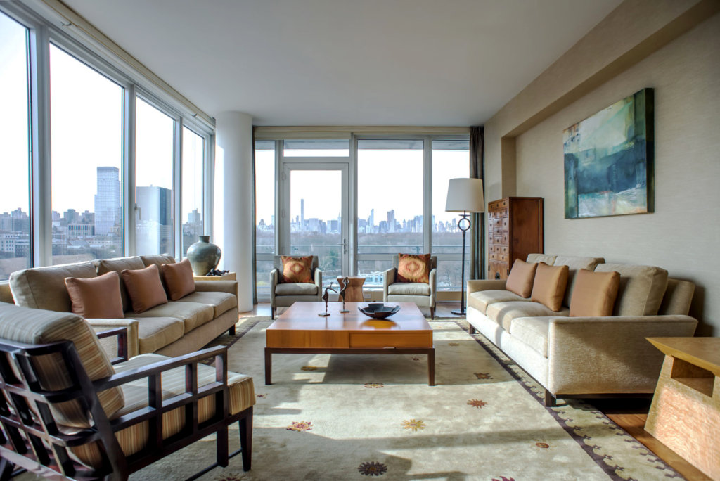 NYC living room scene with floor to ceiling windows