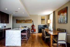 open concept kitchen and dining room with a stand up bass in the background