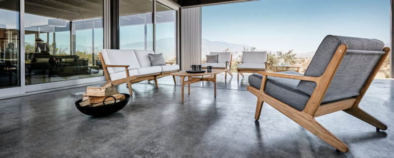 Gloster outdoor furniture with a mountain range in the background