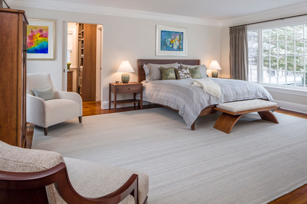 view of a master bedroom with a large white carpet and big bay window