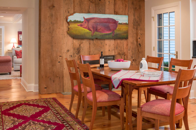 farmhouse dining room with a painting of a pig on the wall