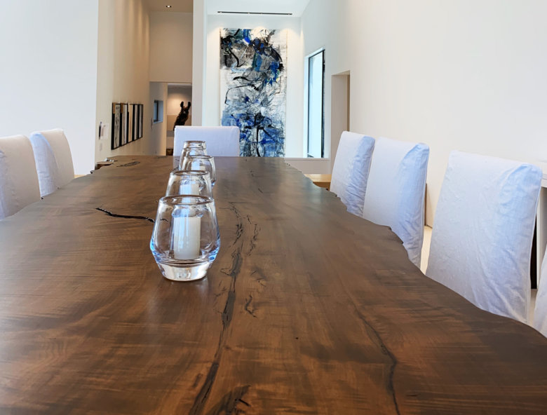 live edge wooden dining room table with glass votives